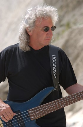 Terry Uttley playing bass guitar