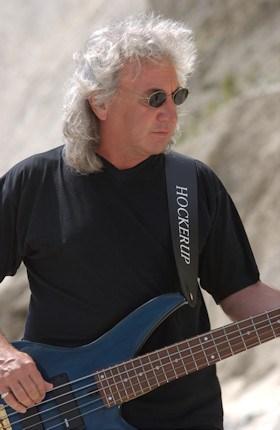 Terry Uttley playing bass guitar